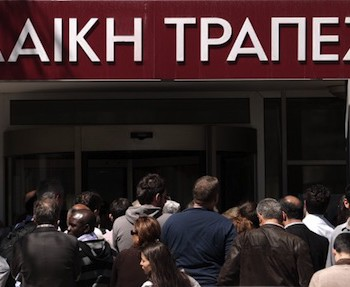 People queue up outside a Laiki bank branch in the Cypriot capital, Nicosia, on March 28, 2013, as they wait for the bank to open after an unprecedented 12-day lockdown. Queues of dozens of people formed before the doors swung open at 12:00pm (1000 GMT) for the first time since March 16, and there were tensions as a few branches opened late, with customers banging on the doors. AFP PHOTO / PATRICK BAZ