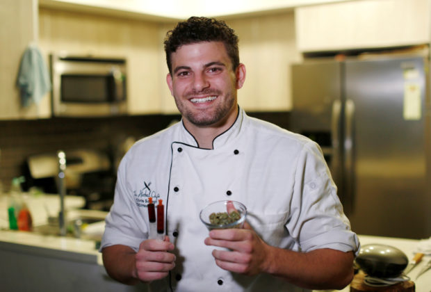 Chef Chris Sayegh holds marijuana buds and THC (Tetrahydrocannabinol) and CBD (Cannabidiol) oils as he poses in his kitchen in Los Angeles, U.S., April 29, 2016. REUTERS/Mario Anzuoni