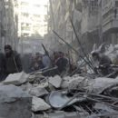 Residents inspect damage after airstrikes by pro-Syrian government forces in the rebel held Al-Shaar neighborhood of Aleppo, Syria February 4, 2016. REUTERS/Abdalrhman Ismail - RTX25GU1