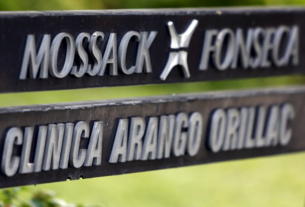 A company list showing the Mossack Fonseca law firm is pictured on a sign at the Arango Orillac Building in Panama City in this April 3, 2016 file photo. REUTERS/Carlos Jasso/Files