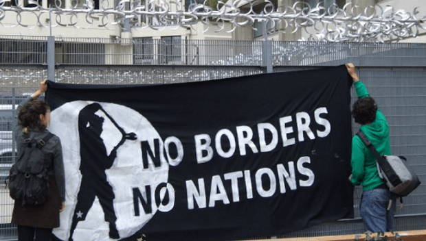 Activists protest a migrant detention center in London. (Photo: noborder.org)