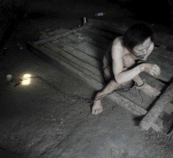 Tong Jieping, 44-year-old mentally disabled patient, is chained by his foot inside his room, in Qunxing village of Wangjiang county, Anhui province, China, July 14, 2015. Tong was diagnosed mentally ill when he was in his 20s. His parents, both in their 70s, could not afford the medical treatments so they had to lock him up in chains to prevent him from running away, according to Tong's family. REUTERS/Stringer CHINA OUT. NO COMMERCIAL OR EDITORIAL SALES IN CHINA         TPX IMAGES OF THE DAY      - RTX1KA0W