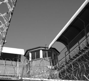 Barbed wire surrounds a tower in Maitland Jail, a former Australian prison, in a photo taken on July 17, 2006. (Photo: Weapons of Mass Distortion)