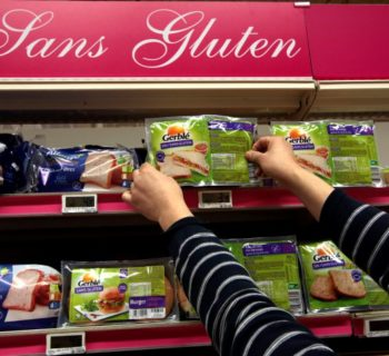 An employee arranges gluten-free products in a supermarket in Nice, France, March 14, 2016.     REUTERS/Eric Gaillard