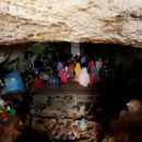 """Internally displaced children attend a class inside a cave in the rebel-controlled village of Tramla, in Idlib province, Syria March 27, 2016. A group of people, who live in a cave, have set up a school for children during the day. The cave accommodates around 120 students, divided into two shifts. REUTERS/Khalil Ashawi  SEARCH """"SYRIA SCHOOLS"""" FOR THIS STORY. SEARCH """"THE WIDER IMAGE"""" FOR ALL STORIES - RTX2IHAG"""