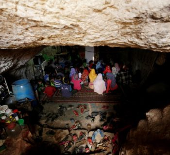 "Internally displaced children attend a class inside a cave in the rebel-controlled village of Tramla, in Idlib province, Syria March 27, 2016. A group of people, who live in a cave, have set up a school for children during the day. The cave accommodates around 120 students, divided into two shifts. REUTERS/Khalil Ashawi  SEARCH ""SYRIA SCHOOLS"" FOR THIS STORY. SEARCH ""THE WIDER IMAGE"" FOR ALL STORIES - RTX2IHAG"