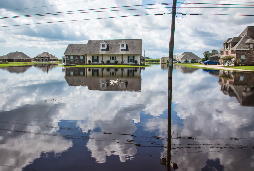Residents in Paulina, Louisiana, say they were able to keep floodwater out of their homes with sandbags and pumps going around the clock.