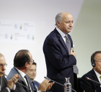 12 Dec 2015, Le Bourget, France --- French Foreign Affairs Minister Laurent Fabius (C), President-designate of COP21, puts his hand over his heart after his speech as he stands near French President Francois Hollande (2ndL) and United Nations Secretary-General Ban Ki-moon (R) at the World Climate Change Conference 2015 (COP21) at Le Bourget, near Paris, France, December 12, 2015. REUTERS/Stephane Mahe --- Image by © STEPHANE MAHE/Reuters/Corbis