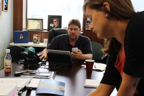 Kerwin Olson and colleague Jennifer Washburn in Olson's office at Citizens Action Coalition in Indianapolis. The group is battling for a faster shift to clean energy in Indiana. Jamie Smith Hopkins / The Center for Public Integrity