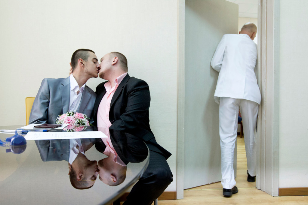 Yaroslav Yevtushenko (left) kisses his boyfriend, Dmitry Chunosov, at St. Petersburg's registry office, where the couple attempted to officially register their marriage as an act of protest. They were promptly rejected by authorities. Credit: Mads Nissen/Catchlight