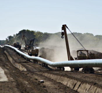 A Caterpillar Inc. side booms drive along the right-of-way during construction of the Flanagan South crude oil pipeline outside Goodfield, Illinois, U.S., on Tuesday, Oct. 8, 2013. The approximately 600-mile, 36-inch crude oil pipeline is being constructed by Enbridge Energy Co., a subsidiary of Enbridge Inc., Canada's largest oil transporter, and will originate in Flanagan, Illinois and terminate in Cushing, Oklahoma. Photographer: Daniel Acker/Bloomberg via Getty Images
