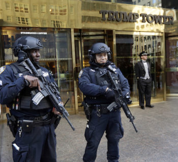 New York City Police officers guard the front of Trump Tower, in New York, Friday, Nov. 11, 2016. The Secret Service and New York City police are going to extremes to protect Donald Trump when he's at his Manhattan home. The president-elect's neighbors near Trump Tower on Fifth Avenue are now having to navigate swarms of police officers, cement barricades, street closures and checkpoints. Swarms of journalists and the occasional street protest are also making the blocks around the tower tough to navigate. (AP Photo/Richard Drew)