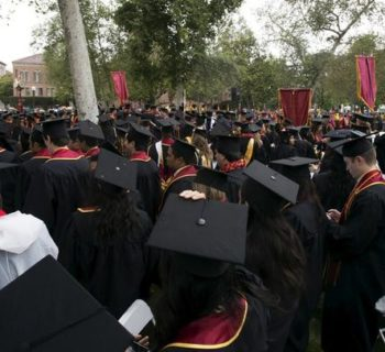 Graduating students attend USC's Commencement Ceremony at the University of Southern California in Los Angeles, California, May 15, 2015. REUTERS/Mario Anzuoni
