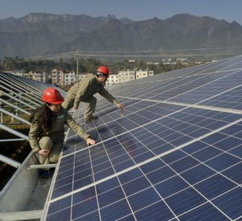 --FILE--Chinese workers check solar panels at a rooftop photovoltaic power station at a plant in Zigui county, central China's Hubei province, 22 December 2016.  China will plow 2.5 trillion yuan ($361 billion) into renewable power generation by 2020, the country's energy agency said on Thursday (5 January 2016), as the world's largest energy market continues to shift away from dirty coal power towards cleaner fuels. The investment will create over 13 million jobs in the sector, the National Energy Administration (NEA) said in a blueprint document that lays out its plan to develop the nation's energy sector during the five-year 2016 to 2020 period. The NEA said installed renewable power capacity including wind, hydro, solar and nuclear power will contribute to about half of new electricity generation by 2020. The agency did not disclose more details on where the funds, which equate to about $72 billion each year, would be spent. Still, the investment reflects Beijing's continued focus on curbing the use of fossil fuels, which have fostered the country's economic growth over the past decade, as it ramps up its war on pollution.