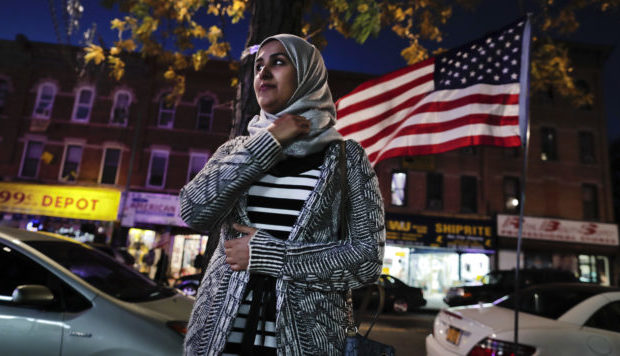 Enas Almadhwahi, an immigration outreach organizer for the Arab American Association of New York, stands for a photo along Fifth Avenue in the Bay Ridge neighborhood of Brooklyn, Friday, Nov. 11, 2016, in New York. American Muslims are reeling over Donald Trump's victory, wondering what the next four years will bring after a campaign in which he proposed creating a national database of Muslims, monitoring all mosques and banning some or all Muslims from entering the country. (AP Photo/Julie Jacobson)