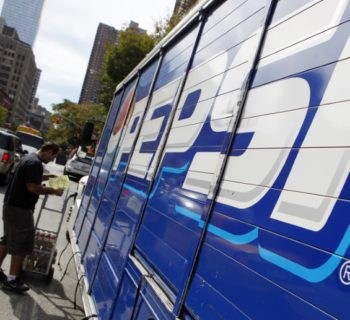 Workers unload a truck of Pepsi products in New York's Hell's Kitchen neighborhood, October 8, 2009.  REUTERS/Chip East