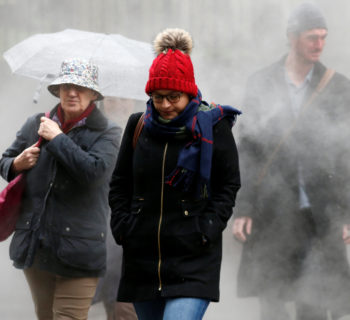 People walk through steam in the financial district during a winter nor'easter in New York City, U.S., January 24, 2017.  REUTERS/Brendan McDermid