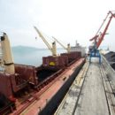A cargo ship is loaded with coal during the opening ceremony of a new dock at the North Korean port of Rajin July 18, 2014. REUTERS/Yuri Maltsev/File Photo