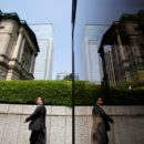 A pedestrian walks past the Bank of Japan building in Tokyo, May 22, 2013.   REUTERS/Yuya Shino/File Photo