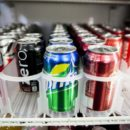 Cans of soda are displayed in a case at Kwik Stops Liquor in San Diego, California February 13, 2014. REUTERS/Sam Hodgson
