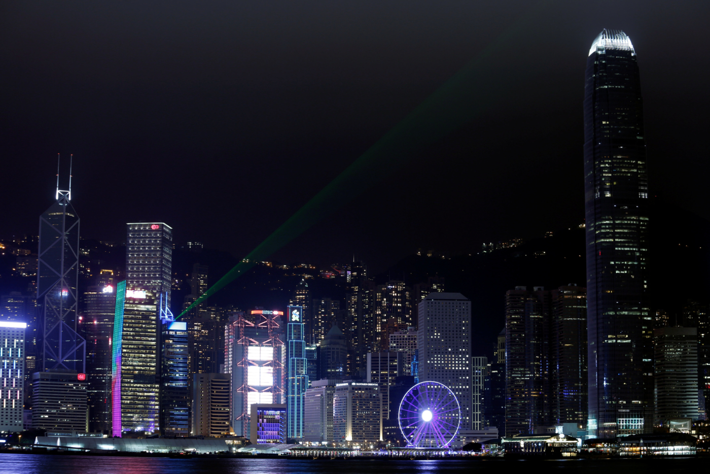 Laser light beams as buildings in the financial Central district are lit up before Earth Hour in Hong Kong, China March 25, 2017.  REUTERS/Bobby Yip