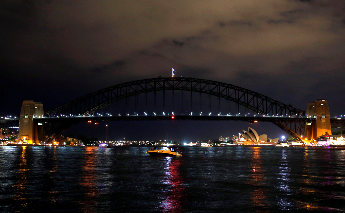 The Sydney Harbour Bridge seen during the tenth anniversary of Earth Hour in Sydney, Australia, March 25, 2017.      REUTERS/David Gray