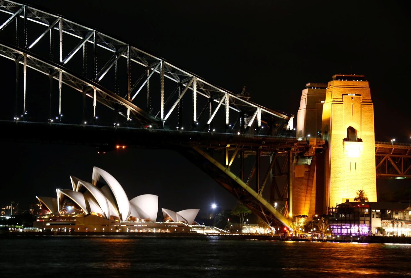 The Sydney Harbour Bridge and Opera House seen before the tenth anniversary of Earth Hour in Sydney, Australia, March 25, 2017.      REUTERS/David Gray
