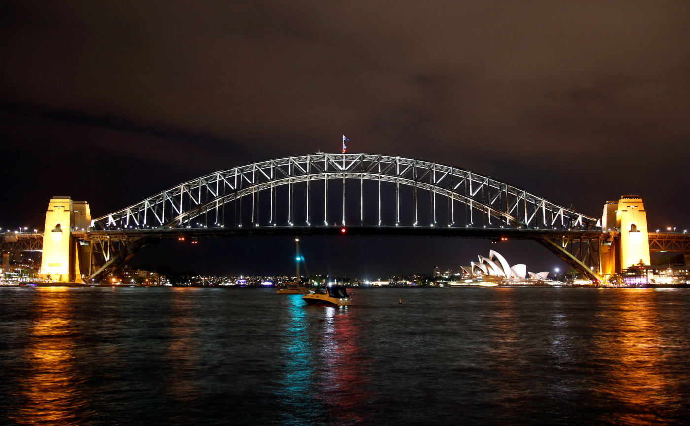 The Sydney Harbour Bridge seen before the tenth anniversary of Earth Hour in Sydney, Australia, March 25, 2017.      REUTERS/David Gray