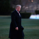 U.S. President Donald Trump walks from Marine One as he returns to the White House in Washington. REUTERS/Joshua Roberts