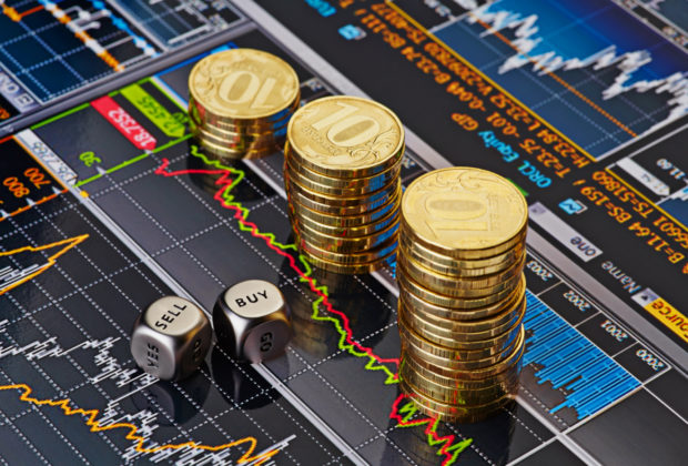 Dices cubes with the words SELL BUY, Uptrend stacks of golden coins. Financial chart as background. Selective focus